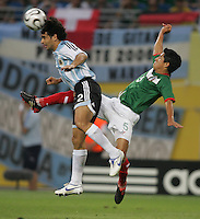 Argentinian defender (2) Roberto Ayala heads the ball away from Mexican defender (5) Ricardo Osorio.  Argentina defeated Mexico, 2-1, in overtime in their FIFA World Cup round of 16 match at Zentralstadion in Leipzig, Germany, June 24, 2006.