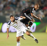 CARSON, CA – SEPTEMBER 18:  LA Galaxy forward Jovan Kirovski (9) and DC United defender Julius James (2) during a soccer match at Home Depot Center, September 18, 2010 in Carson California. Final score LA Galaxy 2, DC United 1.