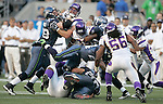 Seattle Seahawks running back Marshawn Lynch dives for extra yardage against the Minnesota Vikings at CenturyLink Field in Seattle, Washington August 20, 2011. The Vikings beat the Seahawks  20-7. ©2011 Jim Bryant Photo. All Rights Reserved.