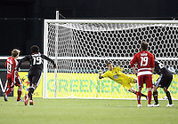 Troy Perkins #23 of D.C. United is beaten by a penalty spot goal from Dax McCarty #13 of F.C. Dallas during a US Open Cup match on April 28 2010, at RFK Stadium in Washington D.C. United won 4-2.