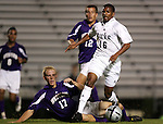 Duke's Zach Pope (16) races past Western Illinois's Luke Greenwell (17) and Jared Appel (12) on Tuesday, October 11th, 2005 at Duke University's Koskinen Stadium in Durham, North Carolina. The Duke University Blue Devils defeated the Western Illinois Leathernecks 2-0 during an NCAA Division I Men's Soccer game.