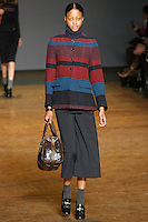 Nyasha Matonhodze walks runway in a prairie indigo multi bablyon blanket jacket, navy t. neck sweater, normandy blue double knit wool pants, faded aluminum turnlock shine shifty bag, and black patent leather oxfords, from the Marc by Marc Jacobs Fall/Winter 2011 collection, during New York Fashion Week, Fall 2011.