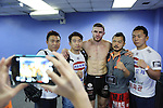 The middleweight MMA winner Russian Vitaly Bigdash poses with fans and fighters<br />