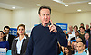 David Cameron speech 7th March 2015 <br /> <br /> Prime Minister David Cameron makes a speech in North London to mark two months until the General Election.<br /> at the Dhamecha Lohana Centre, Brember Road, Harrow London Great Britain <br /> <br /> PPC Hannah David looks on <br /> <br /> <br /> Photograph by Elliott Franks <br /> Image licensed to Elliott Franks Photography Services