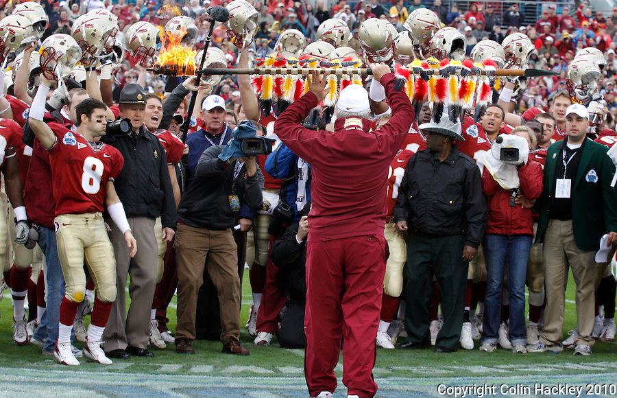 JACKSONVILLE, FL 1/1/10-FSU-WV FB CH23-Florida State Head Coach Bobby Bowden lifts the flaming spear over his head before planting it at mid-field prior to playing  West Virginia in the Gator Bowl Friday in Jacksonville, Fla. .COLIN HACKLEY PHOTO