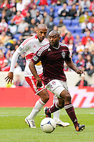Marvell Wynne (22) of the Colorado Rapids is shadowed by Thierry Henry (14) of the New York Red Bulls. The New York Red Bulls defeated the Colorado Rapids 4-1 during a Major League Soccer (MLS) match at Red Bull Arena in Harrison, NJ, on March 25, 2012.