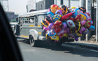 A jeepney full of Party Balloons, Street-Photography life on the streets,  in Manila, Philippines