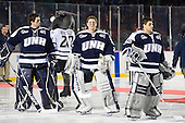 Tyler Scott (UNH - 1), Casey DeSmith (UNH - 29), Matt Di Girolamo (UNH - 30) - The University of Maine Black Bears defeated the University of New Hampshire Wildcats 5-4 in overtime on Saturday, January 7, 2012, at Fenway Park in Boston, Massachusetts.