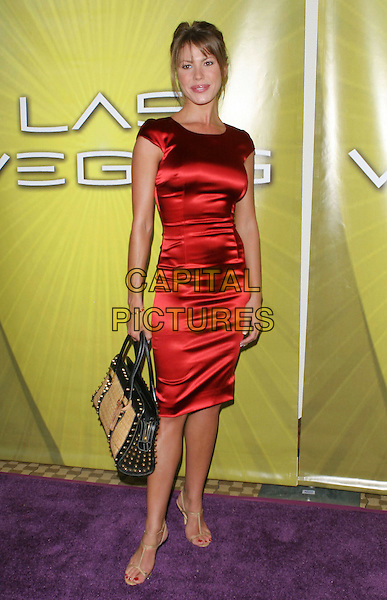 NIKKI COX.Las Vegas Cocktail Party held at The Beverly Hilton, Beverly Hills, CA..July 24th, 2005.Photo credit: Jacqui Wong/AdMedia.full length red silk satin sleeveless dress brown and black straw bag purse.www.capitalpictures.com.sales@capitalpictures.com.© Capital Pictures.
