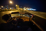 HAVANA, CUBA -- MARCH 25, 2015:   Ariel, a 43 year-old taxi driver,  drives his 1954 Dodge Royal, which was handed down from his grandfather to his father to him, along the Malecon in Havana, Cuba on March 25, 2015.  Photograph by Michael Nagle