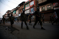 Police clash with stone throwing youth following the arrest of a separatist leader. Srinagar, Kashmir, India. © Fredrik Naumann/Felix Features