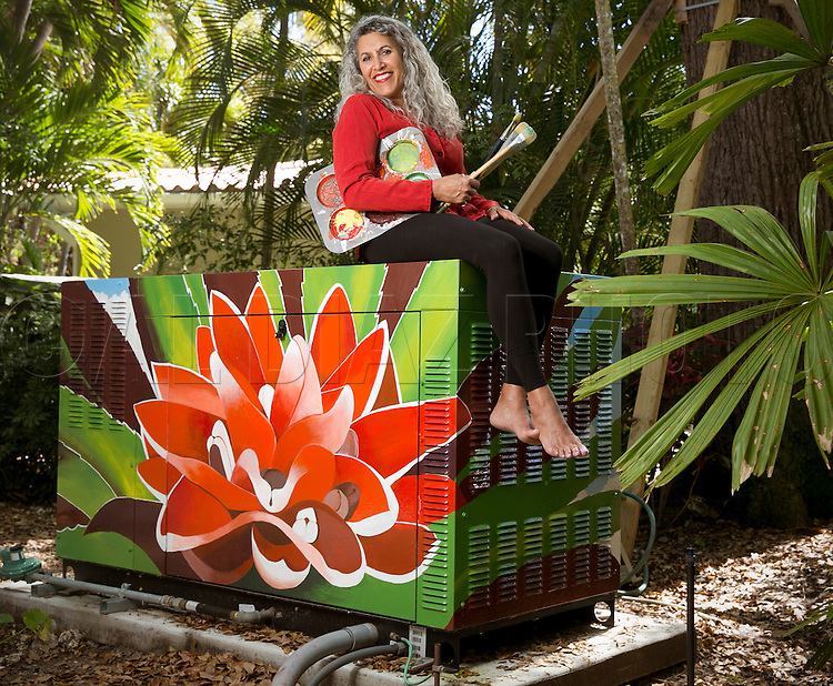 Lisa Remeny is a well-known local artist who was commissioned to paint a bromeliad on a full-house generator. She turned this chunk of machinery into a work of art for judge Pat Seitz and lawyer Alan Greer on Tuesday, March 4, 2014.
