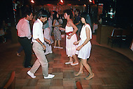 In Ho Chi Minh City, Saigon, February 1988. Young Vietnamese dancing in local discotheque. In main hotels of the city.