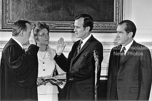 Washington, D.C. - February 26, 1971 -- United States President Richard M. Nixon attends the swearing-in of George H.W. Bush to be the United States Ambassador to the United Nations in Washington, D.C. on February 26, 1971.  .Credit: White House via CNP