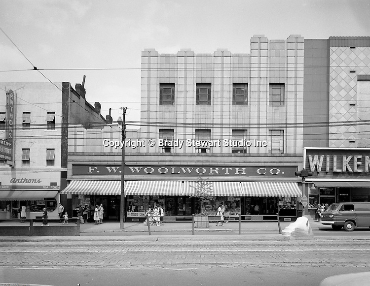 Pittsburgh PA: View of Businesses along Penn Avenue in the East Liberty section of Pittsburgh - 1963.  Stores included: Wilken's Jewelry Store, FW Woolworth and Anthons Bakery and Restaurant.
