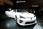 A member of the media takes a photo of the interior of Toyota Motor Corp.'s Lexus LFA during a pre-opening day for the media two days before the start of the 41st Tokyo Motor Show 2009 at Makuhari Messe in Chiba, Japan on Wed., Oct. 21 2009..Photographer: Robert Gilhooly