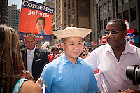NYC Mayoral candidate and Comptroller John Liu joins thousands of Dominican-Americans and their friends and supporters as he campaigns in the Dominican Day Parade in New York on Sixth Avenue on Sunday, August 11, 2013.  Politicians, flags and cultural pride were on display at the annual event. Liu's poll numbers are at 6 percent in the field of Democratic candidates for New York mayor and 40 percent of the votes are required to avoid a run-off election. The primary election is approximately one month away. (© Richard B. Levine)