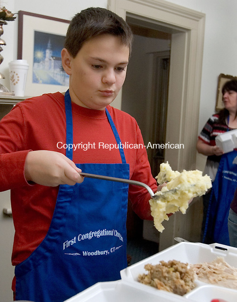 WOODBURY, CT. 22 November 2012-112212SV05- James Ortale, 11, of Southbury serves a big hunk of mashed potatoes during a Thanksgiving dinner at the First Congregational Church in Woodbury Thursday. The event was for anyone who wishes to share meal with others. They serve over 60 dinners at the event..Steven Valenti Republican-American