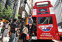 May 5, 2010 - Tokyo, Japan - People enter a Routemaster bus in Tokyo, Japan on May 5, 2010. The double-decker legend is used during the public holidays called 'Golden Week' as free shuttle between Shibuya and Aoyama for the promotion of the British luxury brand group Vulcanize London.