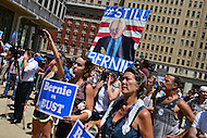 """Philadelphia, PA - July 26, 2016: Protestors display signs in support of presidential candidate Bernie Sanders at a """"Bernie or Bust"""" rally across from City Hall during the Democratic National Convention in Philadelphia, PA, July 26, 2016  (Photo by Don Baxter/Media Images International)"""
