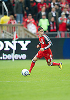 22 October 2011: Toronto FC midfielder Eric Avila #8 in action during a game between the New England Revolution and Toronto FC at BMO Field in Toronto..The game ended in a 2-2 draw.