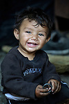 """THIS PHOTO IS AVAILABLE AS A PRINT OR FOR PERSONAL USE. CLICK ON """"ADD TO CART"""" TO SEE PRICING OPTIONS.   Two-year old Kamber Musliu lives in Suto Orizari, Macedonia. The mostly Roma community, located just outside Skopje, is Europe's largest Roma settlement. ."""