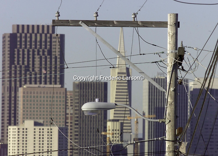 BLACKOUTS1-17JAN00-MN-FRL:  Rolling blackouts affected Northern California.   Chronicle photo by Frederic LarsonA quagmire of telephone lines and power lines engulf city streets up on Potrero hill of San Francisco, California.