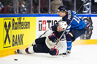 American Jacob Trouba (L) and Finland's Antti Pihlstrom fight for the puck during the Ice Hockey World Championship quarter-final match between the US and Final in the Lanxess Arena in Cologne, Germany, 18 May 2017. Photo: Marius Becker/dpa /MediaPunch ***FOR USA ONLY***
