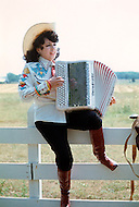 Nashville, Tennessee - June 10, 1977. This photograph was taken of Yvette Horner playing the accordion in Nashville, Tennessee, where she was playing at the Ole Opry. Yvette Horner (born September 22nd, 1922) is a renown French accordionist, whose career has spanned over 70 years, has given thousands of concerts around the world and sold over 30 million records.