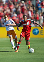 28 July 2012: Toronto FC foward/midfielder Ryan Johnson #9 and Houston Dynamo defender Andre Hainault #31 in action during an MLS game between Toronto FC and the Houston Dynamo at BMO Field in Toronto,Ontario Canada...