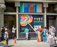 Prospective employees for Dylan's Candy Bar' s Union Square store fill out applications in front of the soon-to-be-opened store in New York on Thursday, August 20, 2015. Founded by Dylan Lauren, Dylan's Candy Bar sells over 7500 confections including their own private label and nostalgic candies in its 11 locations and online. (© Richard B. Levine)