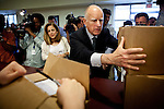 Gov. Jerry Brown delivers boxes of petitions for his initiative to temporarily raise income taxes on high earners and increase sales taxes for four years at the Sacramento County Registrar of Voters in Sacramento, Calif., May 10, 2012.