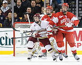 Patch Alber (BC - 27), Charlie Coyle (BU - 3), Alex Chiasson (BU - 9) - The Boston College Eagles defeated the Boston University Terriers 3-2 (OT) in their Beanpot opener on Monday, February 7, 2011, at TD Garden in Boston, Massachusetts.