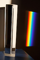 WHITE LIGHT IS REFRACTED BY A TRIANGULAR PRISM<br />