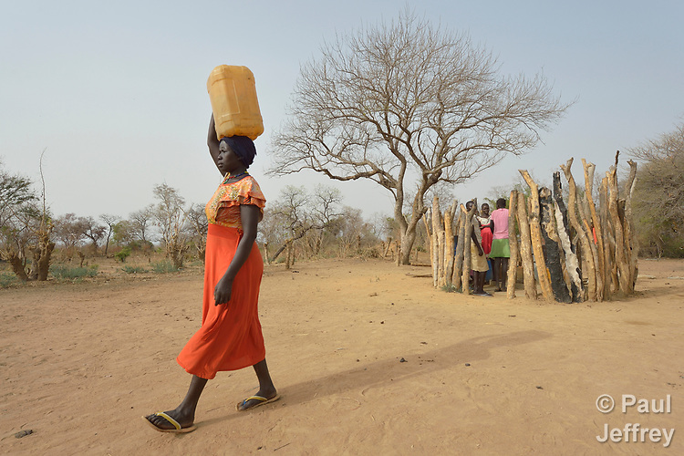 Regina Abuk carries water home from a well dug by the ACT Alliance in Yang Kuel, a village in South Sudan's Lol State where a persistent drought has destroyed crops and forced people to eat wild leaves to survive.<br /> <br /> The well was drilled in 2016 by a local partner of Christian Aid, a member of the ACT Alliance. The organization has also distributed food vouchers to hungry families in the region.