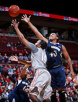 Ohio State Buckeyes guard Ameryst Alston (14) and Old Dominion Lady Monarchs forward Destinee Young (40) chase a rebound during Friday's NCAA Division I basketball game at Value City Arena in Columbus on November 22, 2013. Ohio State won the game 75-60. (Barbara J. Perenic/The Columbus Dispatch)