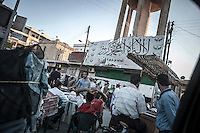 """Al Danna downtown market street. At the north of the Syrian country the so called """"liberated villages"""" start to reorginize themselves leading by the FSA and the most educated scholars under the """"Liwas"""" and """"Qateebas"""", prototypes of civilian commettees."""