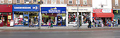 Three charity shops and a discount store all in a row.  These shops usually spring up when a neighbourhood's income drops and unemployment rises.