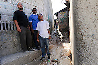 Andy Chaggar and EDV staff assessing the site of a damaged orphanage, Port-au-Prince, Haiti. EDV is committed to affecting permanent change in disaster-affected communities worldwide. Their role is to facilitate personal connections between volunteers and the survivors of disasters.  The charity is based on a proven model developed by several landmark organisations that have paved the way for citizens to become disaster volunteers. These landmark organisations have shown that supposedly ordinary people working together with the guidance of knowledgeable leaders can make an extraordinary difference in the lives of those affected by disaster..EDV believe that to provide meaningful relief and reconstruction assistance to disaster affected communities they have to do more than reconstruct buildings. They need to understand and address the factors that made a community vulnerable to the disaster in the first place. The charity's work is organised with these factors in mind so that they can affect change that far outlives their presence..EDV believes that survivor motivation is essential to the recovery of any disaster-affected community. Their operations will always be predicated on the idea that survivors may be traumatised, but they are not helpless. With this in mind, EDV encourages host communities to direct their own recovery. EDV believe that this empowerment is essential in helping survivors feel a renewed sense of control over their lives which will, in turn, help overcome the feelings of hopelessness that can follow a disaster and inhibit long term recovery. EDV also believe that social cohesion is of primary importance in any disaster-affected area. No amount of bricks or mortar will bring about sustainable improvement if communities fail to come together or are disrupted by relief efforts. Therefore, their operations will always aim to foster communication and cooperation within and between the communities they serve.