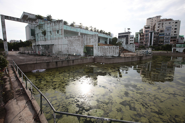 Algae fills the pond and paint peels from the walls of a building in the 23/9 park in Pham Ngu Lao ward, Ho Chi Minh City, Vietnam. July 5, 2011.