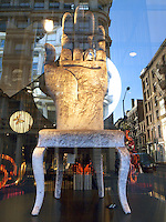 USA. New York City. Sigis shop window in Soho ( Lower Manhattan).  A deluxe straight-backed chair with a palm of a hand for sale. Fashion. 25.10.2011 &copy; 2011 Didier Ruef