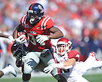 Ole Miss' Brandon Bolden (34) is tackled by Arkansas linebacker Ross Rasner (35) at Vaught-Hemingway Stadium in Oxford, Miss. on Saturday, October 22, 2011. .