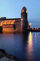 Eglise Notre Dame des Anges, Collioure, France, seen from the sea in the evening. The bell tower was converted from a medieval lighthouse and the Mediterranean Gothic style nave was built in 1684. The dome was added to the bell tower in 1810. Picasso, Matisse, Derain, Dufy, Chagall, Marquet, and many others immortalized the small Catalan harbour in their works. Picture by Manuel Cohen.