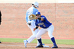 13 February 2015: Seton Hall's Sal Annunziata (11) catches a pickoff throw holding North Carolina's Skye Bolt (20) on first base. The University of North Carolina Tar Heels played the Seton Hall University Pirates in an NCAA Division I Men's baseball game at Boshamer Stadium in Chapel Hill, North Carolina. UNC won the game 7-1.