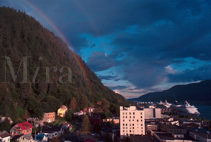 A passing summer storm brings out a brief rainbow over downtown Juneau, Alaska