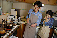 "Shoichi and Chisato Uchiyama cooking insects in their kitchen at home in Tokyo. Tokyo resident Shoichi Uchiyama is the author of ""Fun Insect Cooking"". His blog on the topic gets 400 hits a day. He believes insects could one day be the solution to food shortages, and that rearing bugs at home could dispel food safety worries."