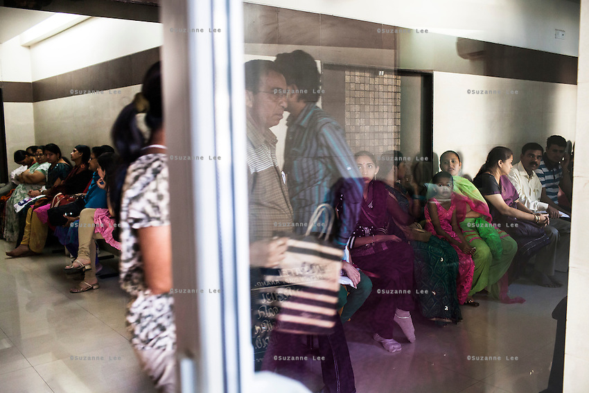 Patients wait around to see the doctors at the Akanksha Infertility Center in Anand, Gujarat, India on 12th December 2012.  Photo by Suzanne Lee / Marie-Claire France