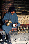Marsh Arabs. Southern Iraq. Circa 1985. Marsh Arab man pouring coffee. Haur al Mamar or Haur al-Hamar marsh collectively known now as Hammar marshes Irag 1984