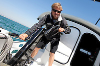 "24th May 2010. Portsmouth. UK..Pictures of yachtsman Alex Thomson onboard his new ""Hugo Boss"" IMOCA Open 60. Shown here sailing in the eastern Solent...Mandatory credit: Lloyd Images"
