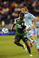 Jorge Perlaza (15) forward Portland Timbers goes past Chance Myers (7) defender Sporting KC..... Sporting Kansas City defeated Portland Timbers 3-1 at LIVESTRONG Sporting Park, Kansas City, Kansas.